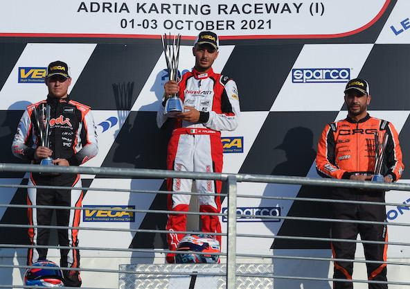 Le podium général de la WSK Open Cup en KZ2 avec Renaudin (à g.) et Iglesias (à dr.) autour de Palomba